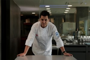 Diego Gallegos at Sollo with kitchen in background