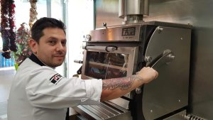 Diego Gallegos with the Pira 70ED charcoal oven.