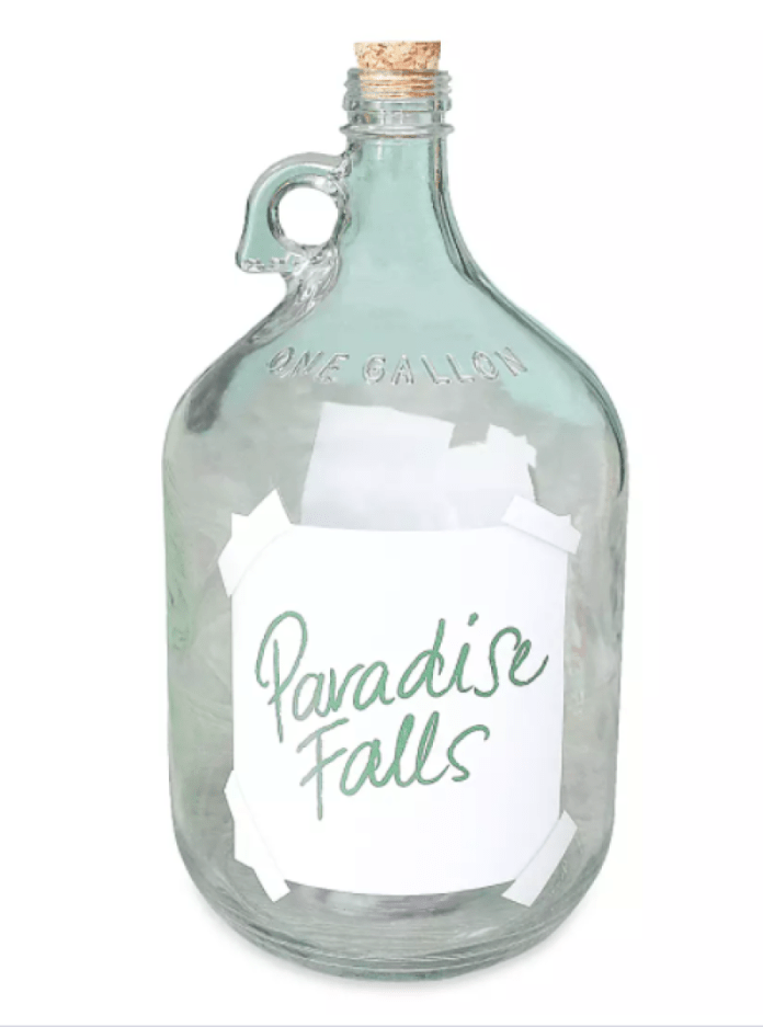 Glass jug with a cork and a label that reads