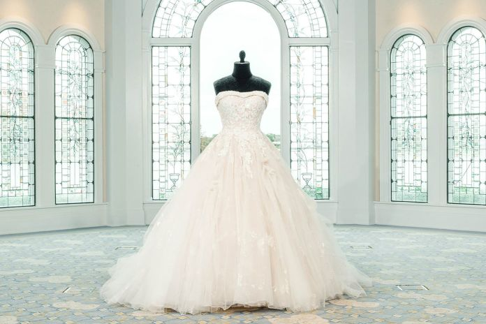 Belle's inspired dress was specially created with a spectacular shimmering brocade featuring a beautiful rose pattern. Soft pickups across the sparkling tulle overlay lend additional texture and draw design inspiration from Belle's timeless ballgown silhouette