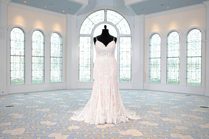Intricate, shimmering appliques cover the richly sequined Tiana-inspired gown. Emulating the elegant designs and heavy beadwork of the Jazz Age, this gown is truly fun with a perfectly vintage flair.