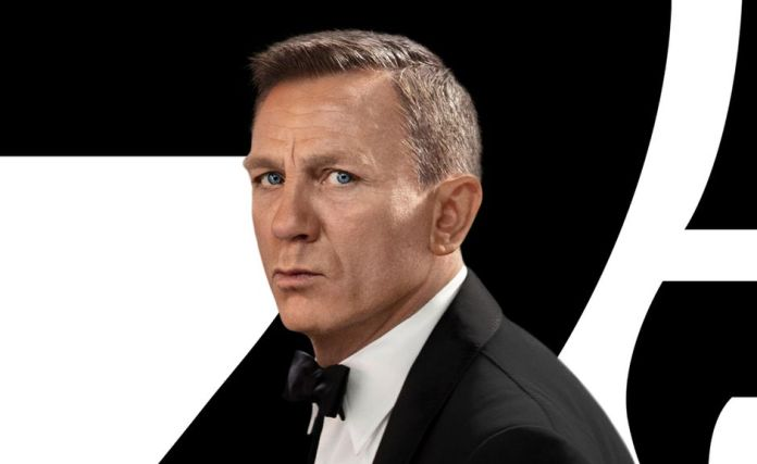 Daniel Craig in a suit as the character James Bond