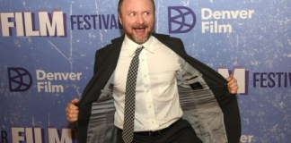Rian Johnson with his jacket open trying to be funny