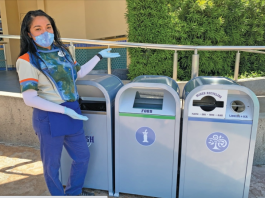 Galactic Grill cast member at Disneyland posing with new food waste bin