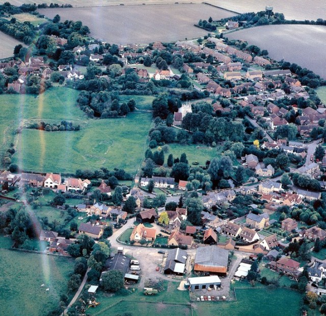 An aerial photo showing the first phase of houses built on the farmyard.