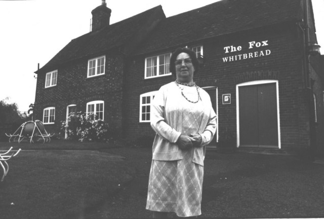 1950  May Cook, the licensee, at the bar of the Fox. May came from a family of publicans, her parents John and Rose Walker took over the Fox in 1912 and her grandparents Jim and Eliza Walker ran the Shoulder of Mutton in Hambridge Way. Her great grandparents John and Elizabeth ran the White Horse. May died in 1978 and the typical village pub never seemed the same again.