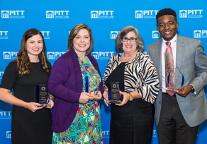 During a reception on campus Tuesday, the PCC Alumni Association presented awards to Jessica Yelverton, Jennifer Smith, Lisa Owens and La'Quon Rogers, left to right, for their accomplishments professionally, in the community and in service to the college.