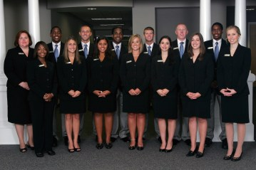 group of students all in black suits from 2011