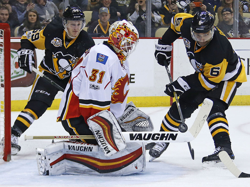 Flames snap Penguins' three-game win streak in shootout