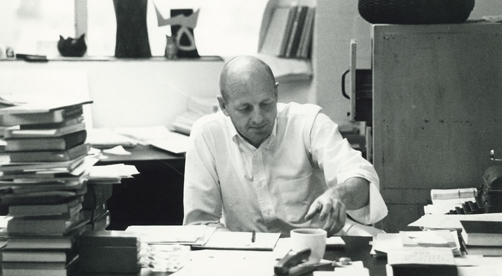Founding faculty member Lee Munroe, professor of anthropology, in his office in 1969.
