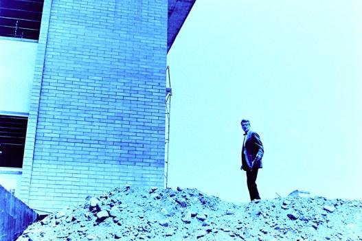 Man Stands Near Building, 1964