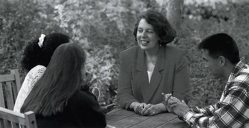 President Massey Sitting with Students, undated