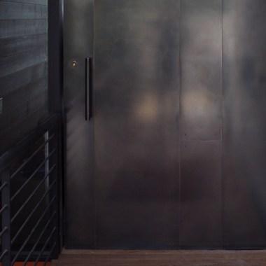Blackened stainless steel door