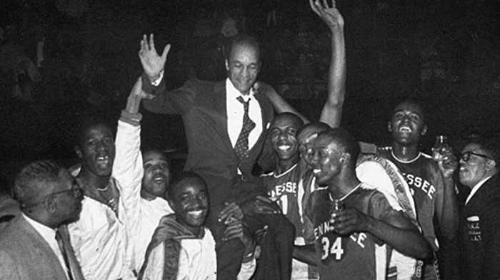 Tennessee State basketball coach John McLendon being hoisted up by players after winning one of his three N.A.I.A. championships.