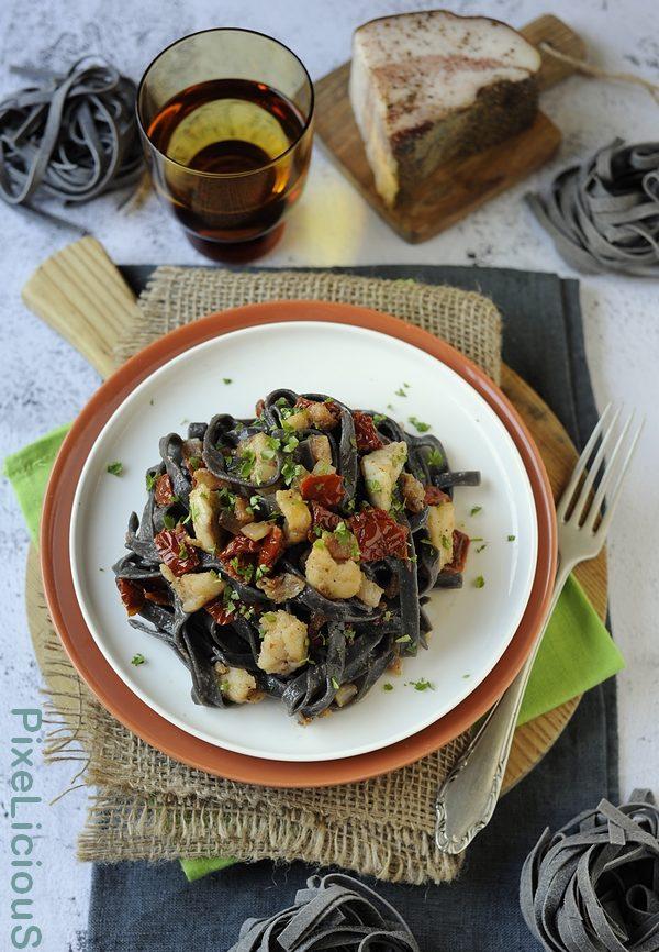 Taglierini al Nero di Seppia con Coda di Rospo, Pomodori Secchi e Guanciale
