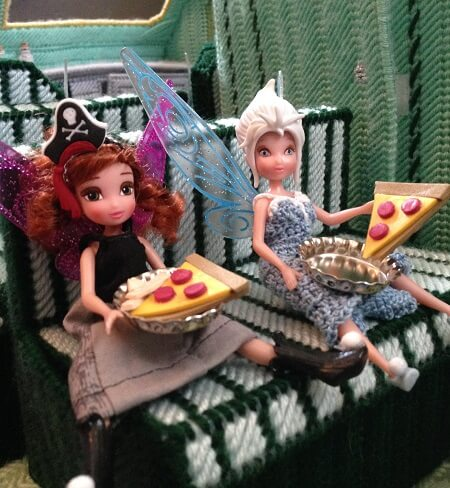 Dolls with craft foam pizza.