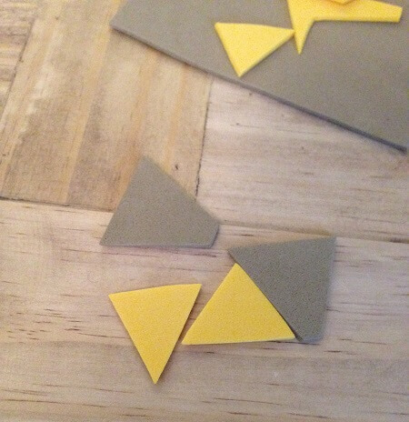 Cut pieces of brown and yellow foam to make doll pizza.