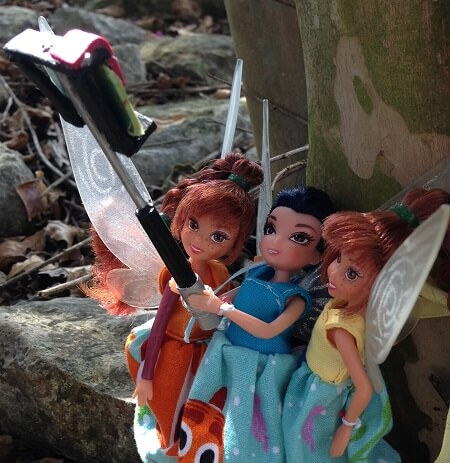 Fairies outside with selfie stick.