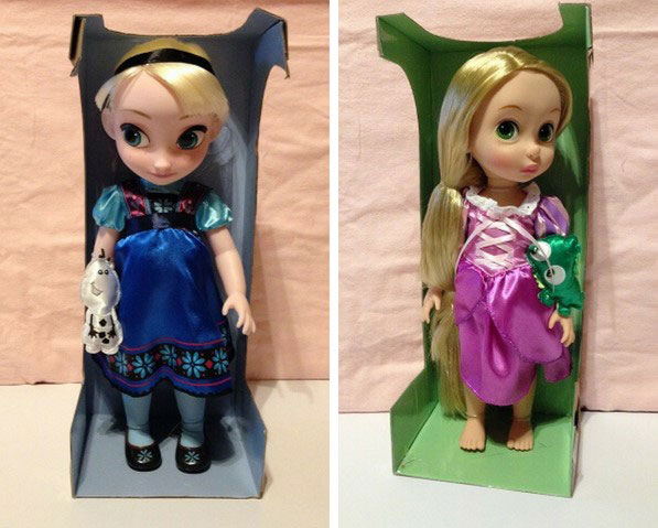 Unboxing Disney Animator dolls.
