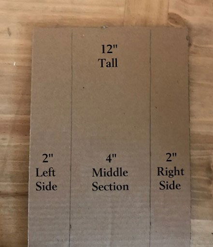 "Cardboard Doll Bed With Measurements: 12"" tall by 8"" wide."