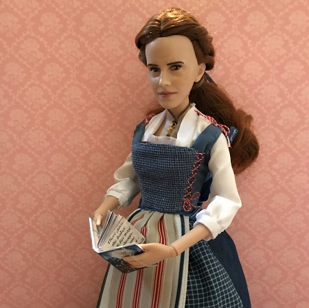 Belle doll holding new book