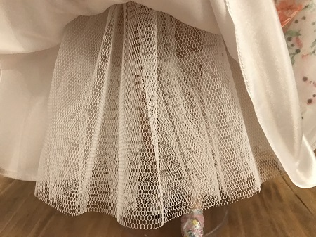 White Petticoat Beneath Skirt