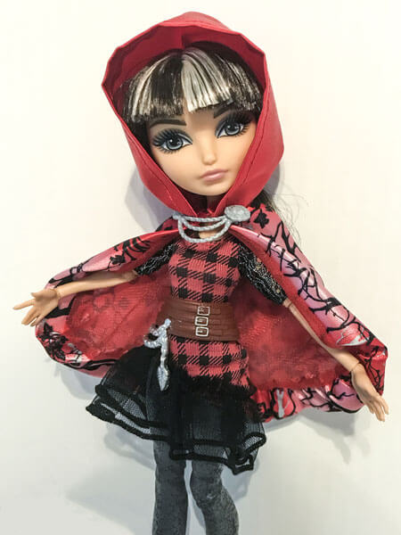 Cerise Hood Showing Off Her Cape