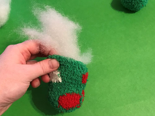 Add stuffing to cat toy.