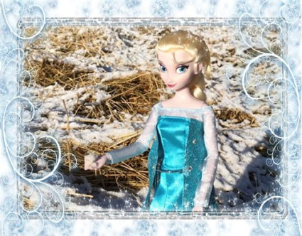 Image Of Elsa Holding Snowball With Icy Swirl Frame