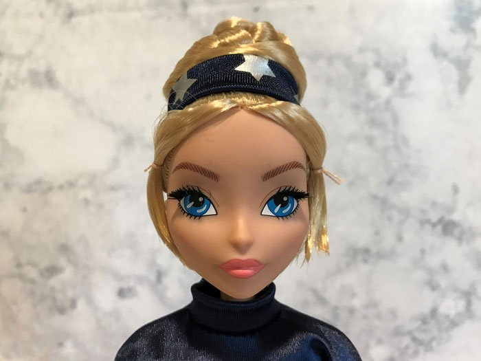 Close Up Image Of Captain America Fan Girl Doll.