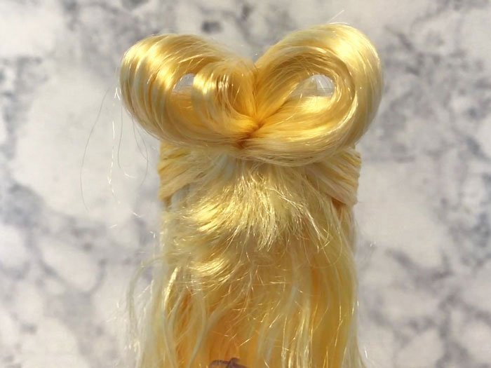 Bow hairstyle for doll.