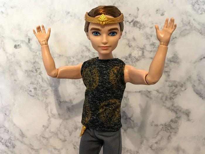 Dexter Charming raising his arms.