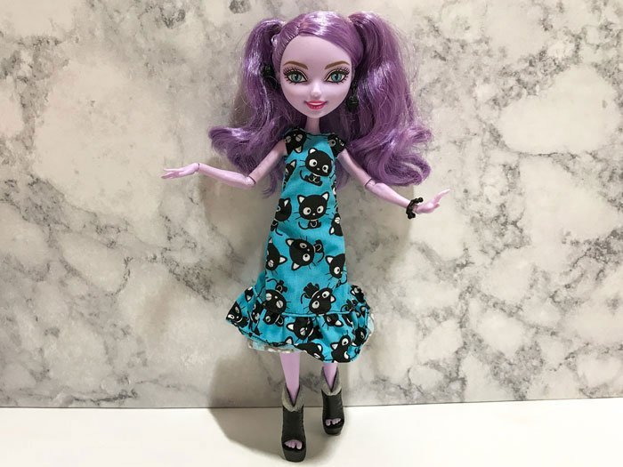 Kitty Cheshire testing out Chococat dress from Barbie Fashion Pack.