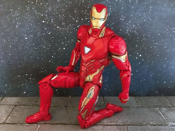 Image of Iron Man action figure kneeling.
