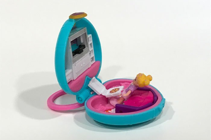 Since the new Polly Pockets don't have hinged legs, it's hard to keep them in a sitting position.