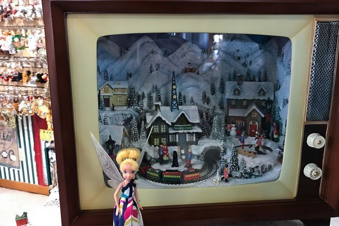 Tinkerbell standing in front of Christmas display @pixiedustdolls.