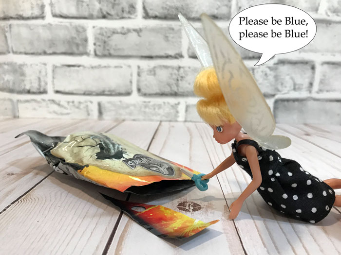 Tink opening fourth Jurassic World blind bag.