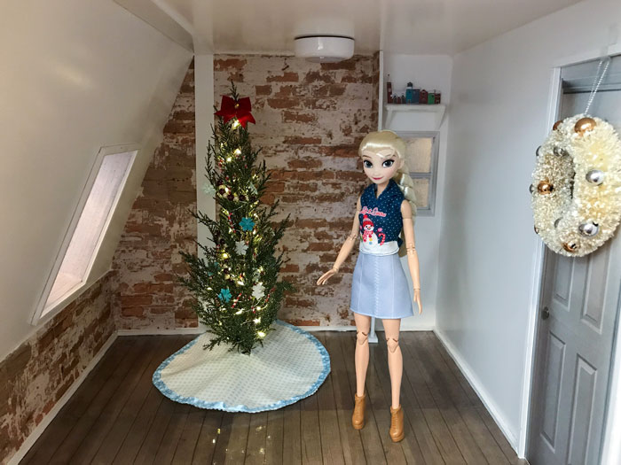 Decorating a doll room for Christmas.