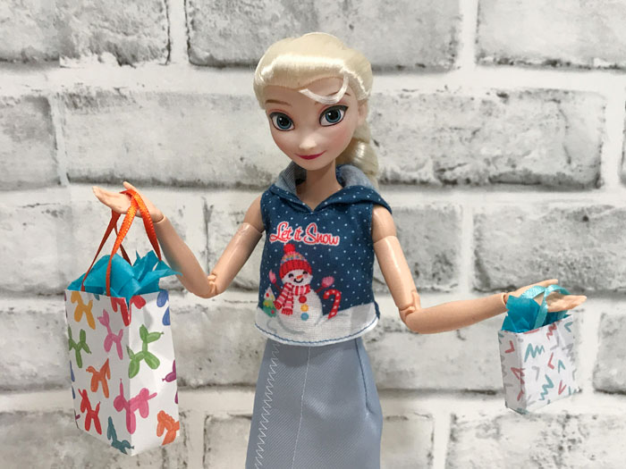 Making miniature gift bags for Barbie dolls.