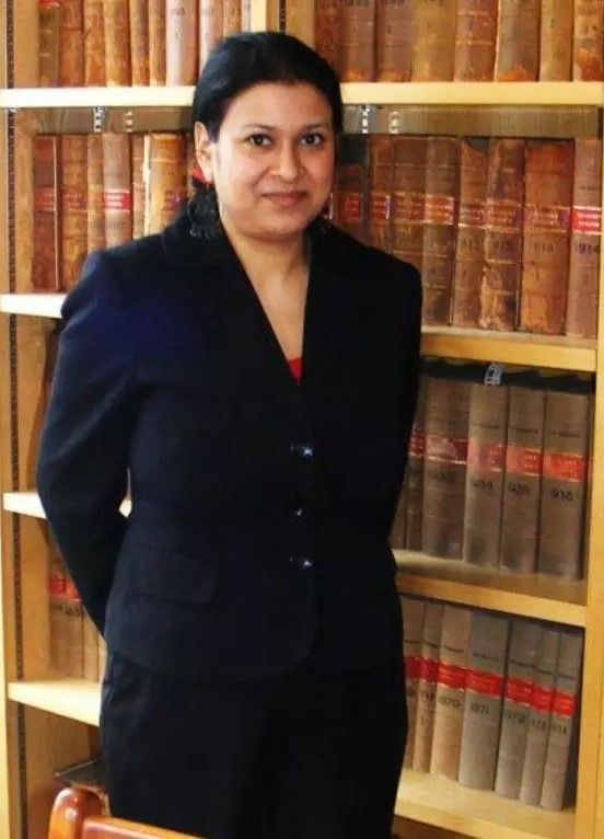 Solicitor Piya Mayenin standing in her office