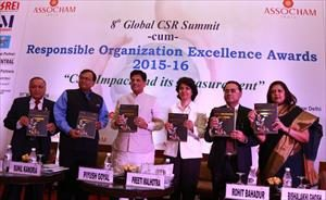 Releasing the CSR Compendium at 8th Global CSR Summit cum Responsible Organization Excellence Awards 2015-16 in New Delhi