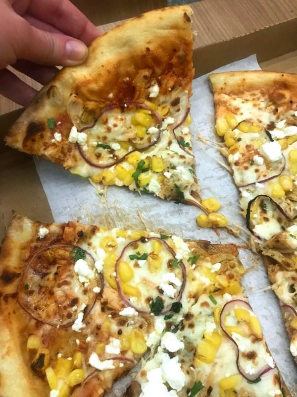 wolfgang puck logan airport pizza