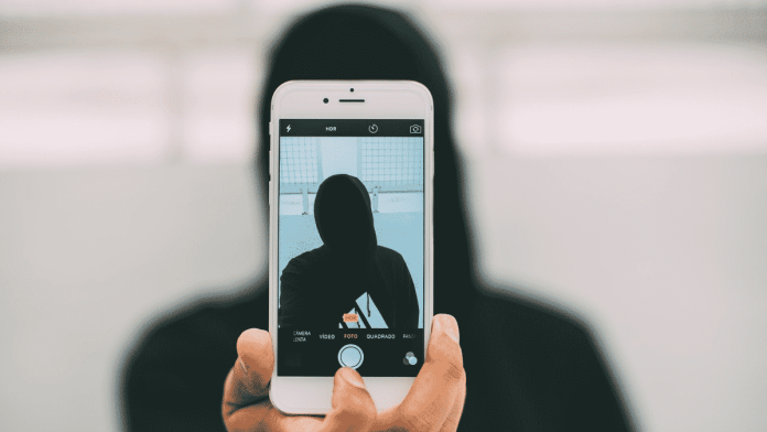 Photo of anonymous person on a cell pohone.