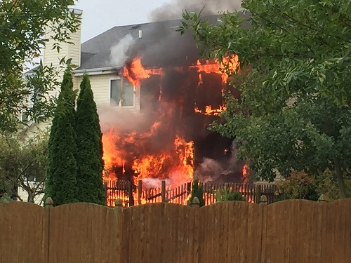 photo of a house on fire