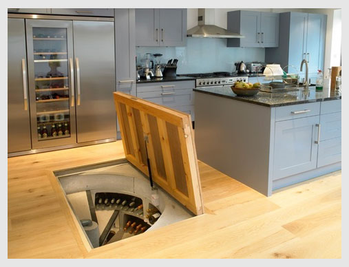 Trap door in the kitchen opens to store wine