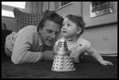 Ray Cusick and his daughter with a small test model of his Dalek design.