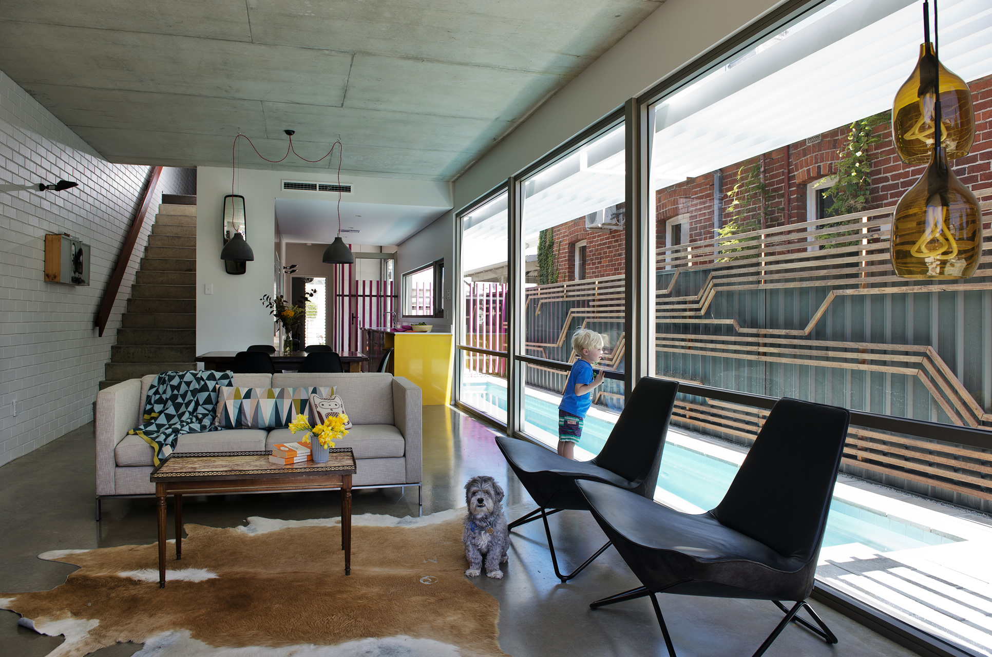 In its design we note fun references to europe such as eames chairs tolix of the outside and some prints from ferm living