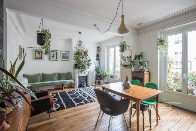 Cuisine ouverte et charme de l'ancien, un parfait appartement parisien