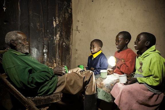 Children with Solar Aid lamp (Source: the Honnold Foundation