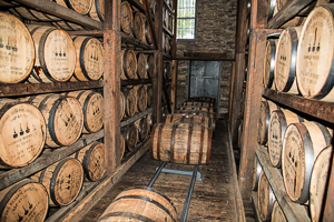 Bourbon barrels in a warehouse